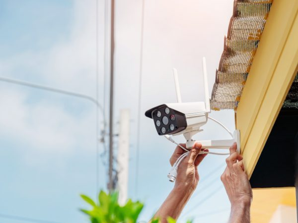 technicians-are-installing-wireless-cctv-camera-front-house-maintain-security